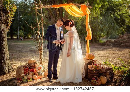 Bride and groom on their wedding fall day