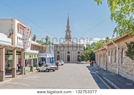 CRADOCK SOUTH AFRICA - FEBRUARY 16 2016: A street scene with businesses and the Dutch Reformed Church built in 1868. Cradock is a medium sized town in the Eastern Cape Province
