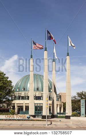 DALLAS USA - APR 7: Flags of the United States and the State of Texas near the Chasae Tower in Dallas. April 7 2016 in Dallas Texas USA
