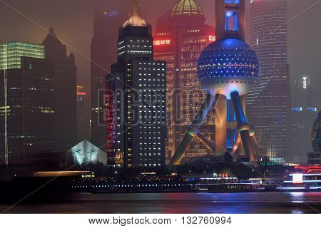 SHANGHAI CHINA - MARCH 19: Pudong district night view from The Bund waterfront area on March 19 2016 in Shanghai China. Pudong is a district of Shanghai located east of the Huangpu River.