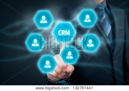 Customer relationship management (CRM) concept. Businessman click on virtual scheme representing CRM.