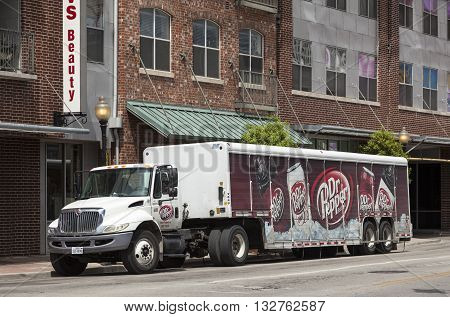 DALLAS USA - APR 7: Dr Pepper delivery truck in a street of Dallas downtown district. April 7 2016 in Dallas Texas United States