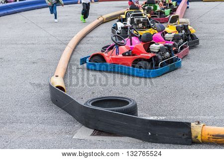 image of karts at amusement park with children