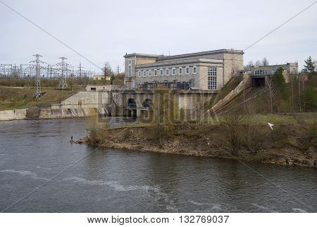 IVANGOROD, RUSSIA - MAY 01, 2015: View of the Narva power plant on a cloudy day. Historical landmark of the   Leningrad region