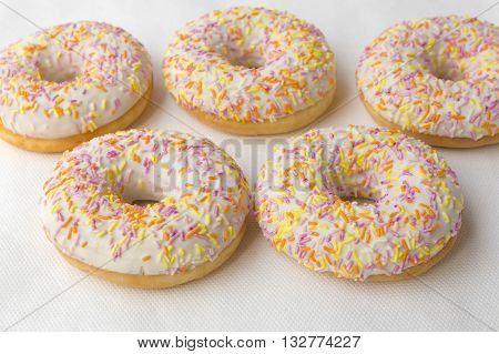 Donuts hot closeup. Crumpet for tea. Tasty food cakes. Classic cakes: fried doughnuts glazed with caramel. Nutritious dish that promotes obesity.