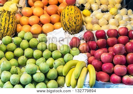 Apples, pears and melons for sale at a market