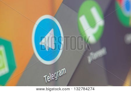 SARANSK, RUSSIA - JUNE 04, 2016: A smartphone screen shows Telegram icon on the screen. Selective focus.