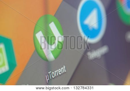 SARANSK, RUSSIA - JUNE 04, 2016:  A smartphone screen shows uTorrent icon on the screen. Selective focus.