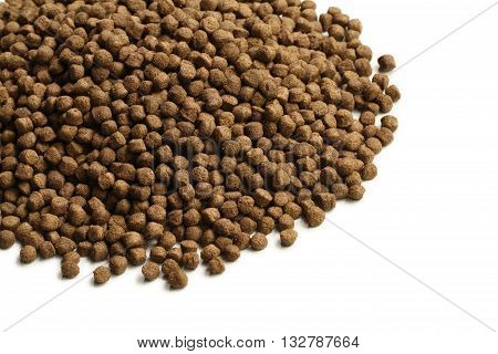 Pile of dry pet food on white background