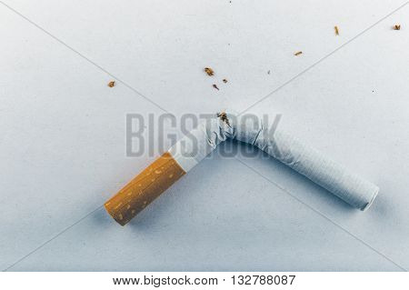 Quit Smoking - Low Contrast Image Of A Broken Unsmoked Cigarette Over White Background