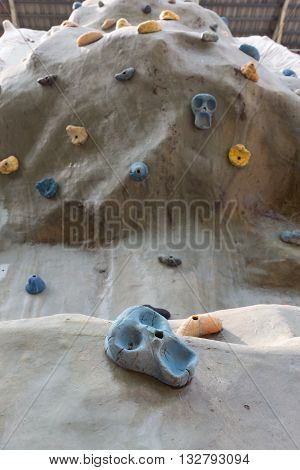 Close up artificial climbing wall in outdoor.
