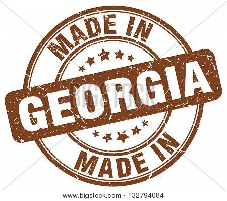made in Georgia brown round vintage stamp.Georgia stamp.Georgia seal.Georgia tag.Georgia.Georgia sign.Georgia.Georgia label.stamp.made.in.made in.