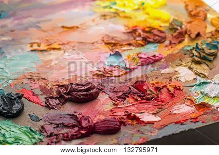 Used Brushes In An Artist's Palette Of Colorful Oil Paint For Drawing And Painting