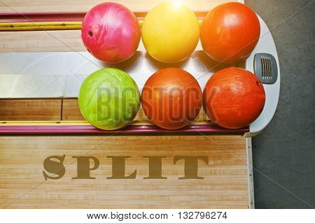 The word split background bowling balls at alley