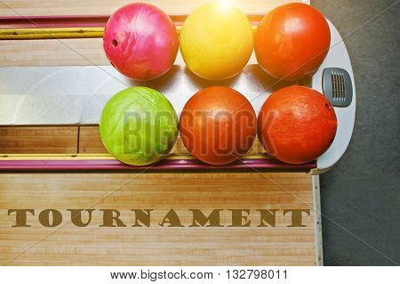 The word tournament background bowling balls at alley