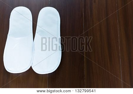 Slippers only use with paper on wooden floor in luxury room copy space.