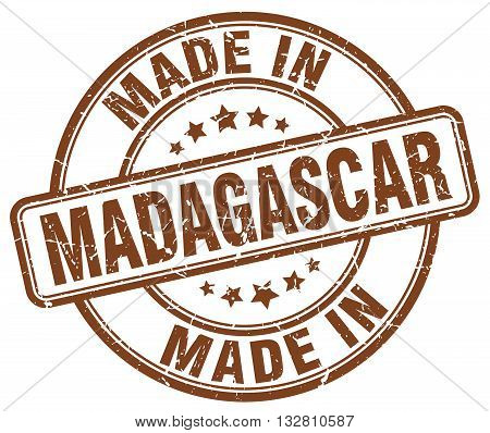 made in Madagascar brown round vintage stamp.Madagascar stamp.Madagascar seal.Madagascar tag.Madagascar.Madagascar sign.Madagascar.Madagascar label.stamp.made.in.made in.