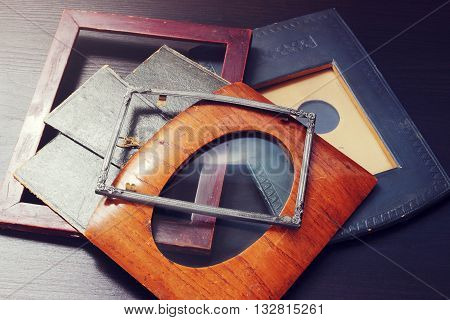 Vintage photo frames from metal, wood and paper. Retro effect