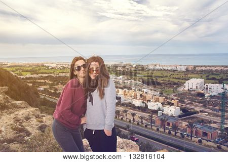 two beautiful lovely girls were photographed over the city