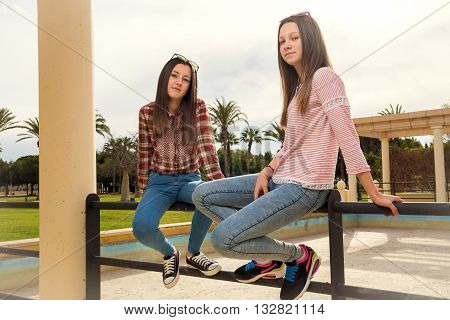 two young girls were photographed in the park