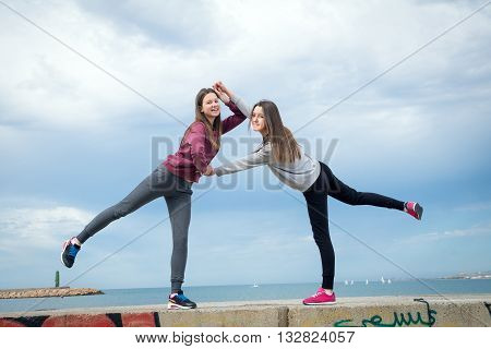 two beautiful young girls were photographed against the sky