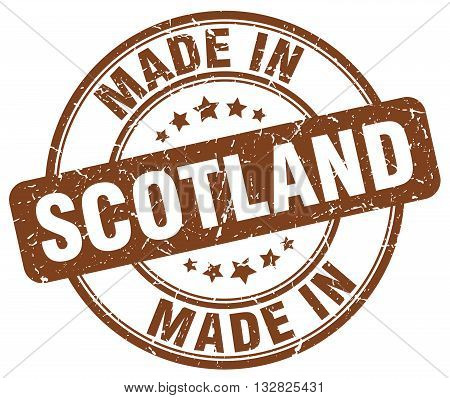 made in Scotland brown round vintage stamp.Scotland stamp.Scotland seal.Scotland tag.Scotland.Scotland sign.Scotland.Scotland label.stamp.made.in.made in.