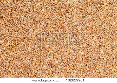 Background Texture Of Fine Ground Brown Bulgur