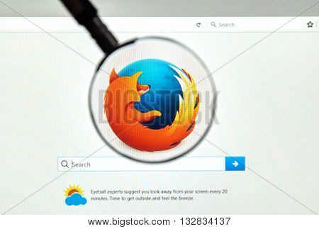 MONTREAL CANADA - JUNE 4 2016 : Firefox web browser under magnifying glass. Firefox is a free and open-source web browser developed by the Mozilla Foundation.