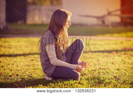 Tween kid girl profile in the park at sunset side view