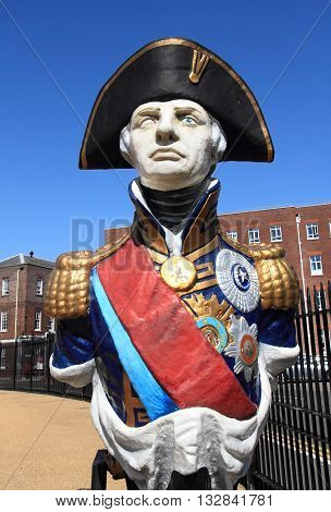 PORTSMOUTH, UK - JUNE 12, 2014: Statue of Admiral Lord Nelson on June 12, 2014 in Portsmouth, UK. The statue is displayed in Portsmouth historical dockyard to commemorate this national hero.