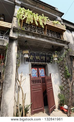 SHENZHEN, CHINA - MARCH 28, 2016: Traditional village house at Dapeng Fortress on March 28, 2016 in Shenzhen, China. Dapeng Fortress is a historic landmark walled village in Guangdong province.