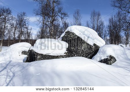 Boulders, rocks on the mountainside.  Still very much of snow, and the March Equinox past a few days ago.
