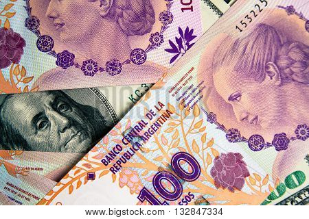 Several bills of 100 pesos with the face of Eva Peron on $ 100 bill