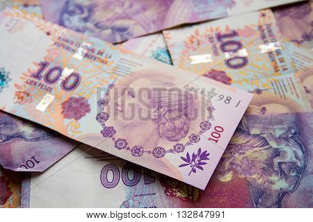 Several bills of 100 pesos with the face of Eva Peron