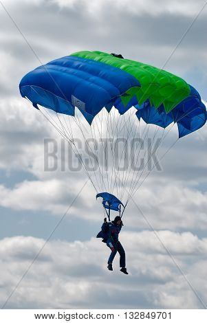 Yalutorovsk, Russia - May 24, 2008: Sport airdrome. Paratrooper woman descends and trains in landing accuracy