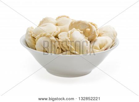 Uncooked frozen varenyky (dumplings) with mashed potatoes covered with hoar-frost in ceramic bowl on a light background poster