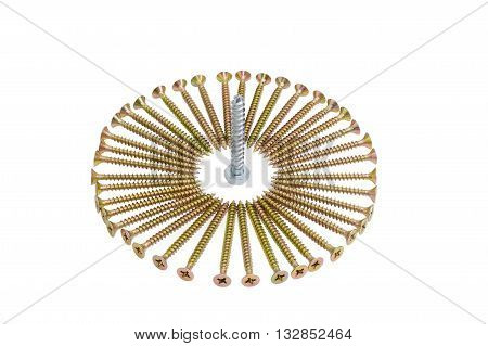 Zinc plated chipboard screws with countersunk heads stacked in a circle and a lag bolt in the center closeup on a light background