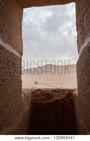 Desert view via a fortress window in Palmyra Syria. It is saddening that Palmyra's present Roman ruins declared by UNESCO as a world heritage site have come to be endangered in the 21st century by regional military and political strife.