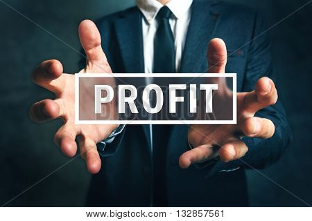 Concept of gaining business profit businessman grabbing profit with his hands