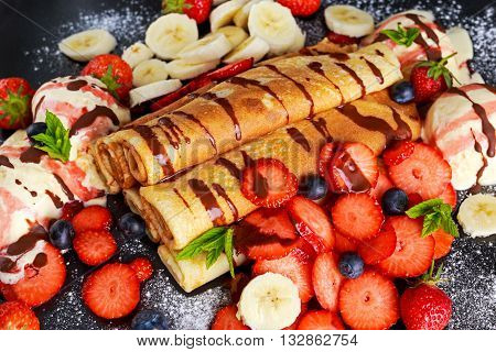 Sweet Rolled Pancakes with nutella, strawberry, blueberry, banana and ice cream