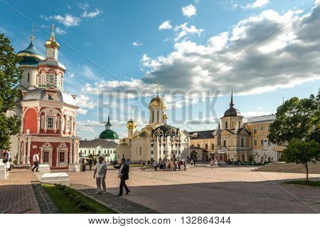 Sergiyev Posad Russia - June 01 2016: Central square with a shadow from a belltower in Troitse-Sergiyevsky Lavra in the city of Sergiyev Posad is constructed in 1442.