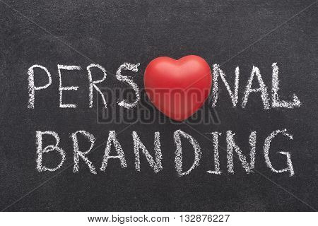 personal branding phrase handwritten on blackboard with heart symbol instead of O
