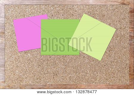 three different color note on corkboard surface