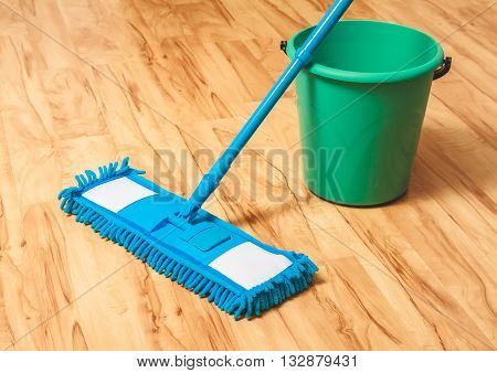 A bucket of water and mop. Wash wood floor concept
