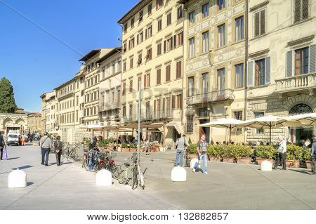 FLORENCE ITALY - October 07.2011: Tourists and citizens walking on a city street along the outdoor cafes