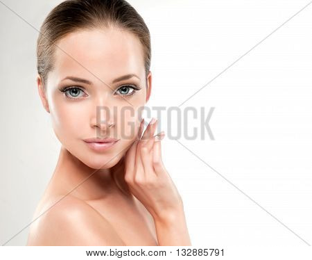 Beautiful Young Woman with Clean Fresh Skin close up . Skin care face . Cosmetology , beauty  and spa