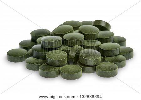 Spirulina pills (superfood) isolated on white background.