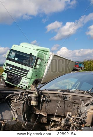 View of truck and car in an accident, cloudy sky