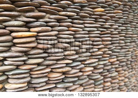 Circle pebble wall abstract used for background