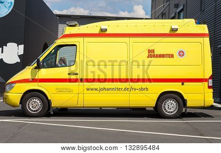 BERLIN / GERMANY - JUNE 3 2016: german ambulance car from Johaniter stands on a building in Berlin / Germany on may 3 2016.